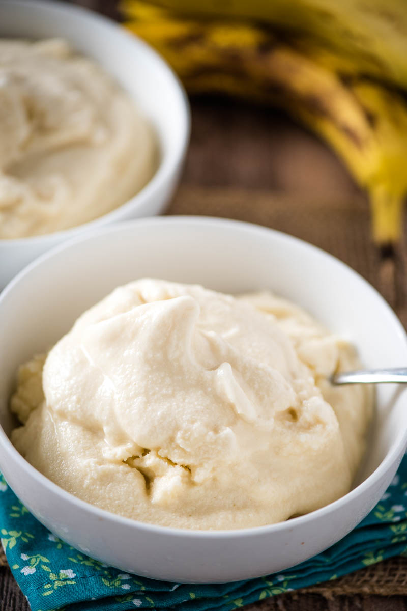 white bowl of soft serve homemade banana ice cream with spoon