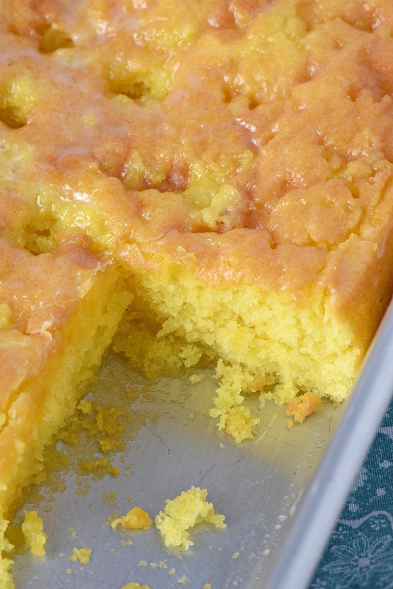 lemon pudding cake in metal cake pan