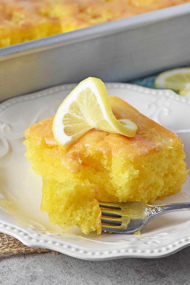bite of easy lemon cake with glaze on fork