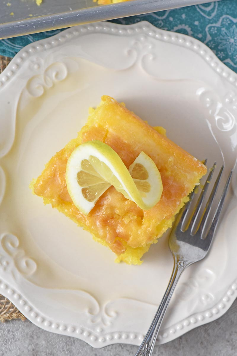 sliced lemon pudding cake on white plate, made with easy lemon cake recipe