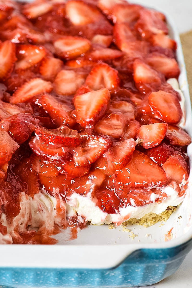 strawberry delight no bake dessert in blue baking dish