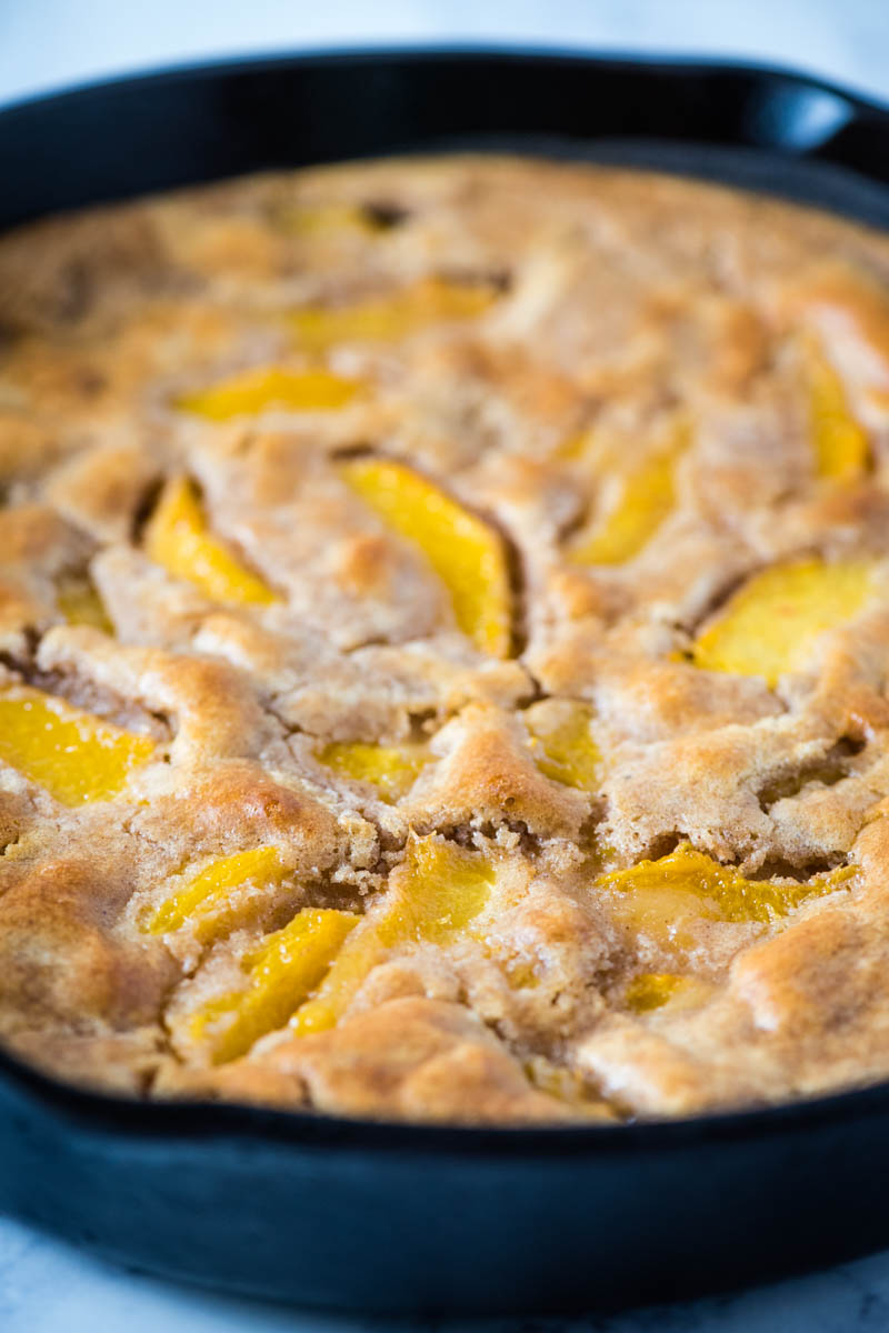 peach cobbler made with Bisquick in cast iron skillet