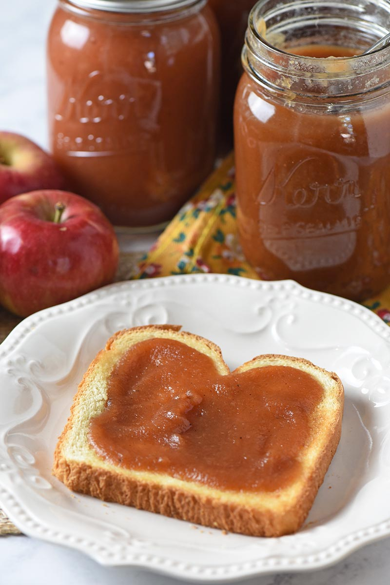 pressure cooker apple butter on toast on white plate
