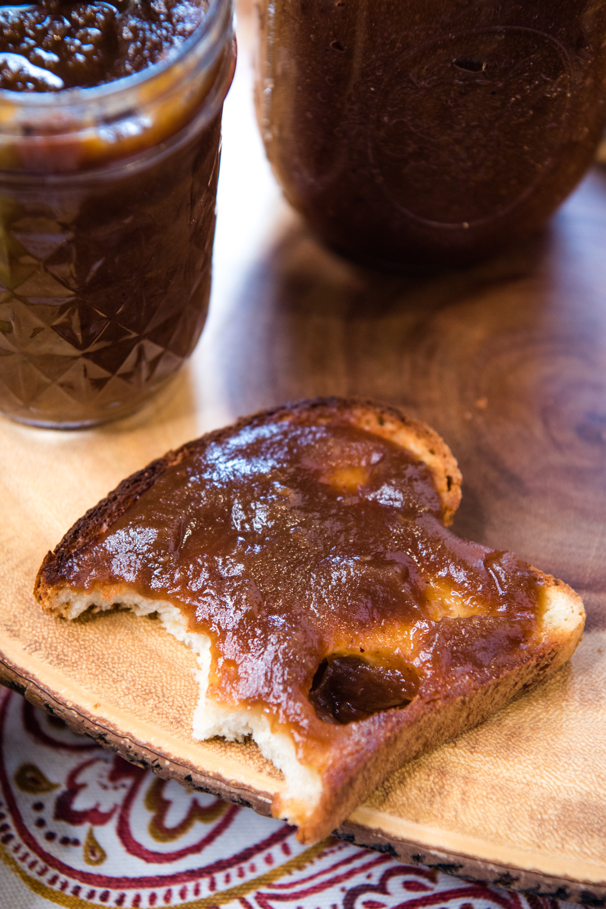 slice of toast with pressure cooker apple butter on log plate