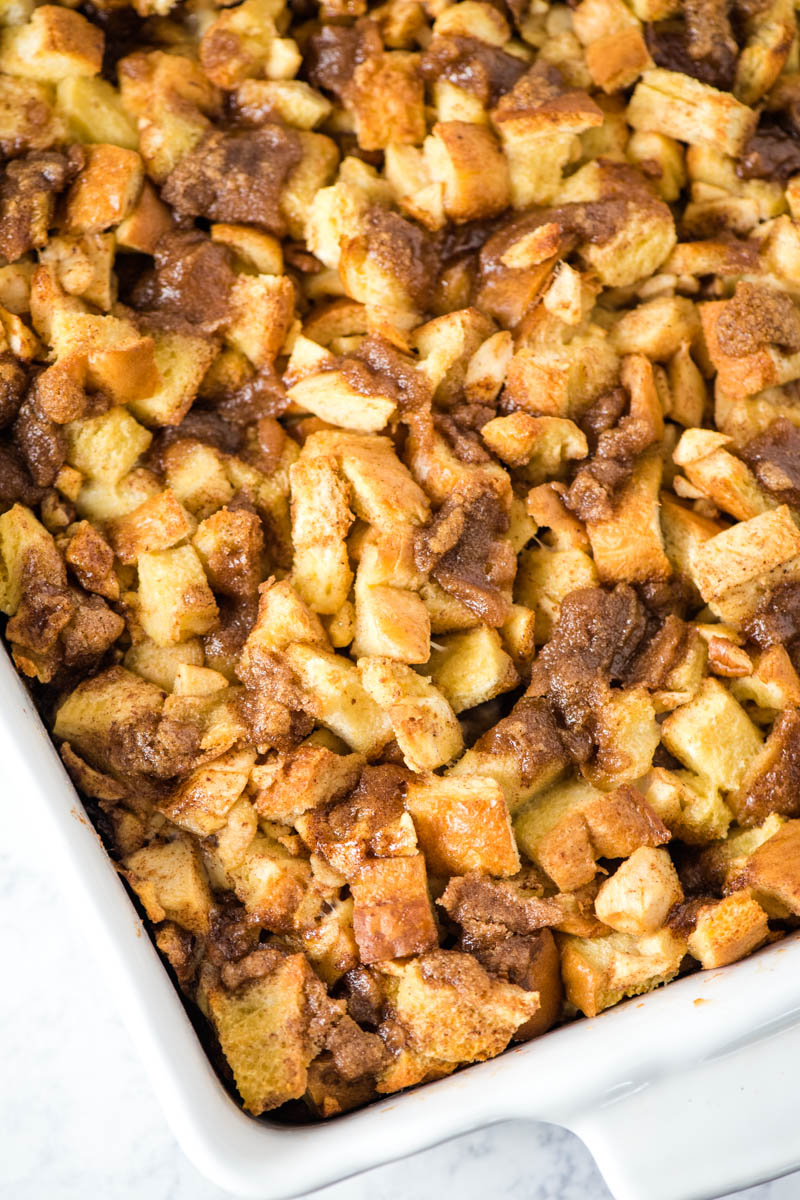 apple French toast bake, baked in white casserole dish