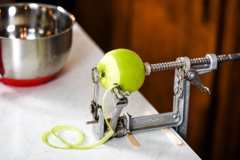apple peeler peeling Granny Smith apple for gluten-free crisp