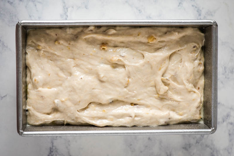 banana bread batter in metal loaf pan