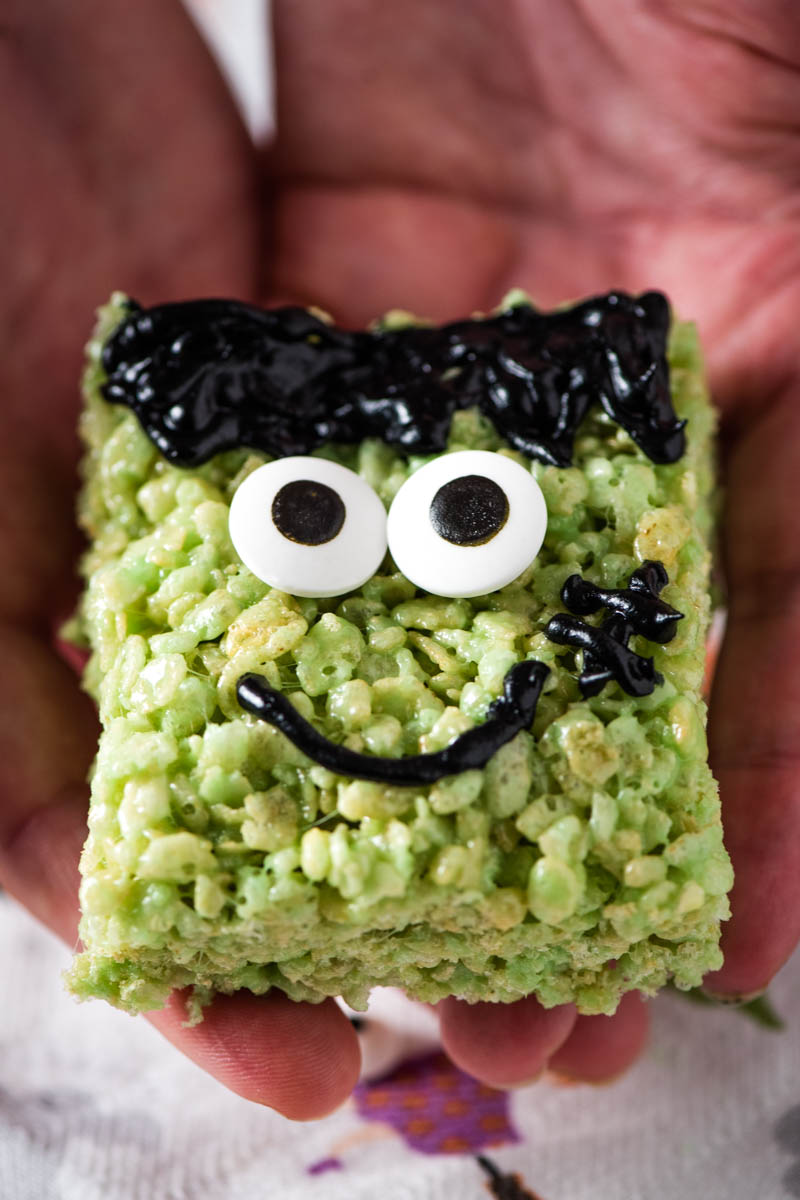 hands holding Frankenstein Rice Krispie treat