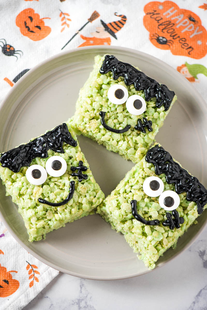 gray plate of Halloween Rice Krispie treats decorated like Frankenstein