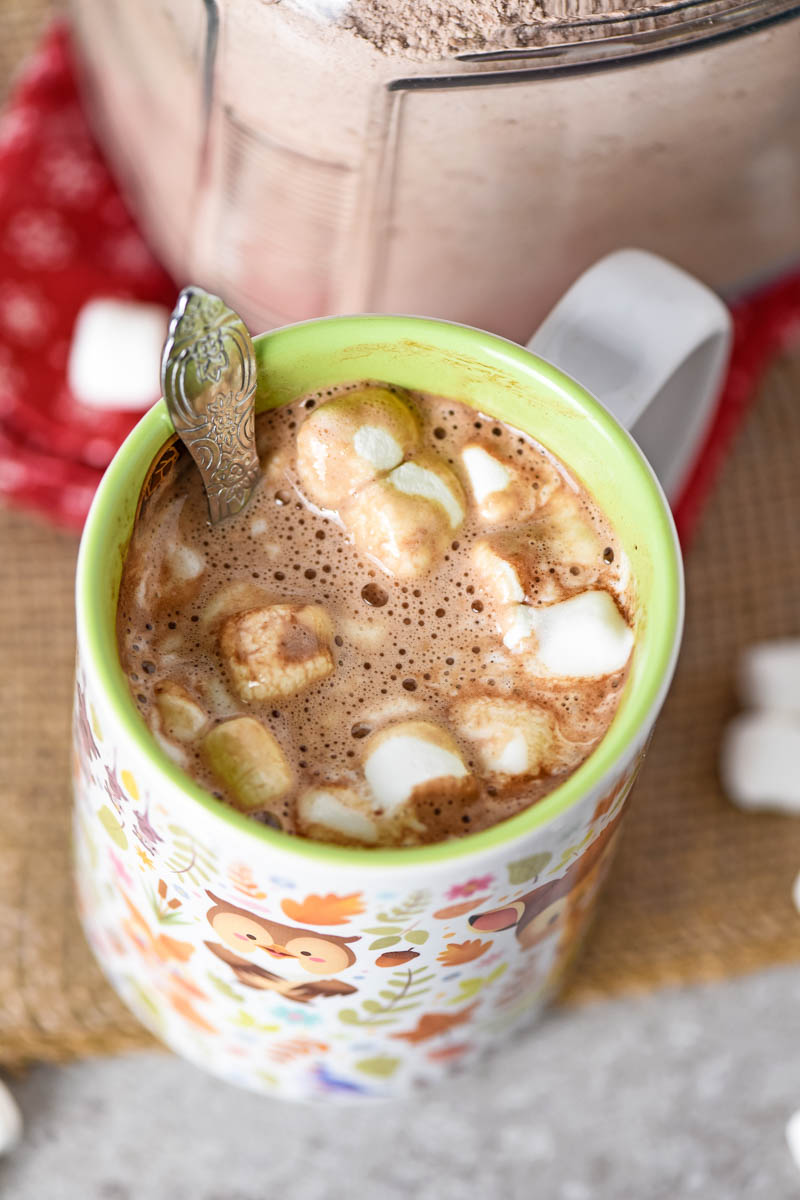 adding homemade hot cocoa mix with water and mini marshmallows to Disney Bambi mug