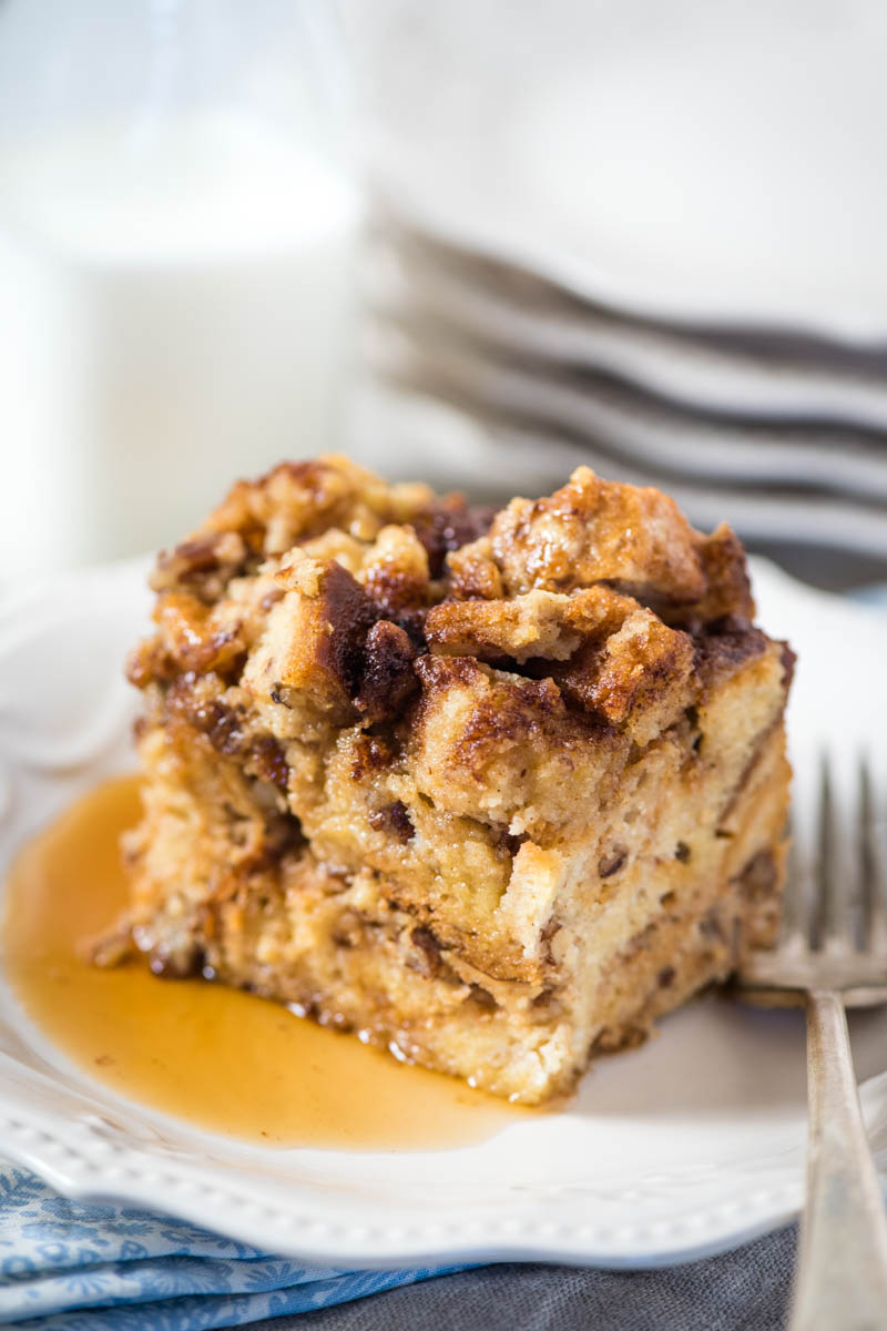slice of Crock Pot French toast casserole on white plate with fork