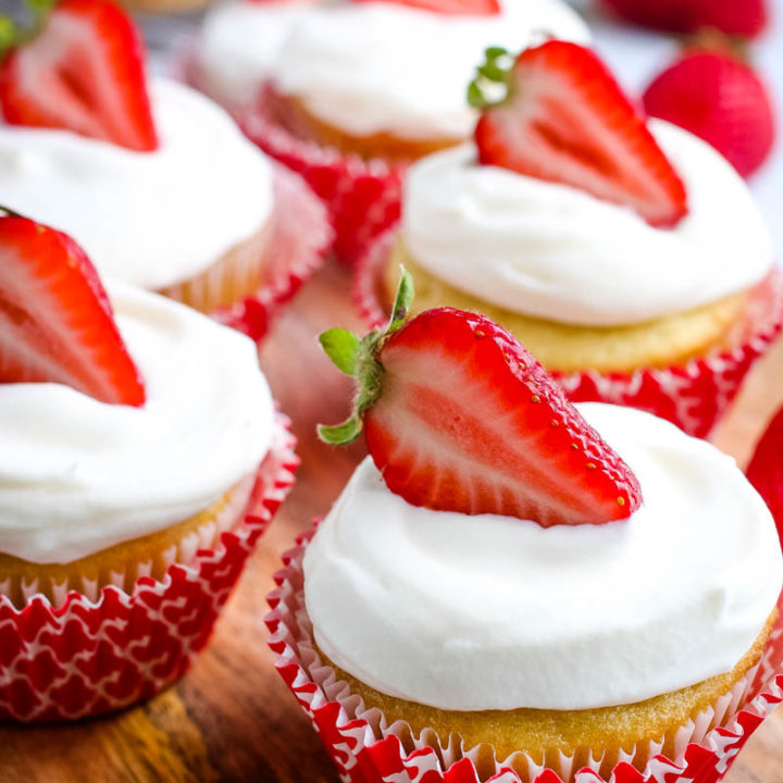 Strawberry Filled Cupcakes with Whipped Cream Frosting
