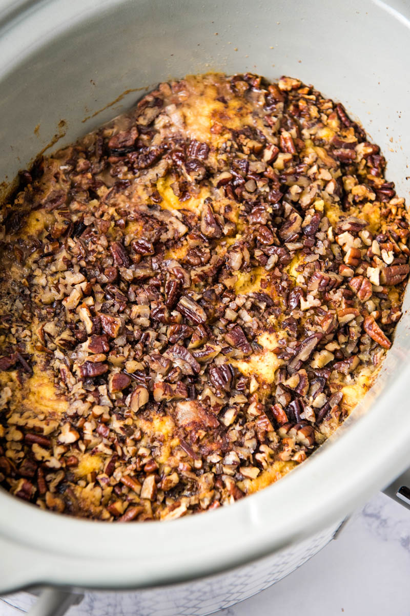 slow cooker apple dump cake baked in a gray slow cooker