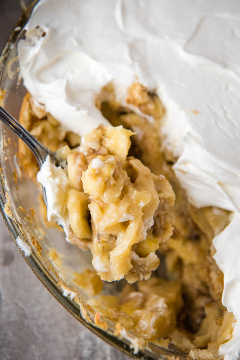 spoonful of homemade banana pudding over casserole dish