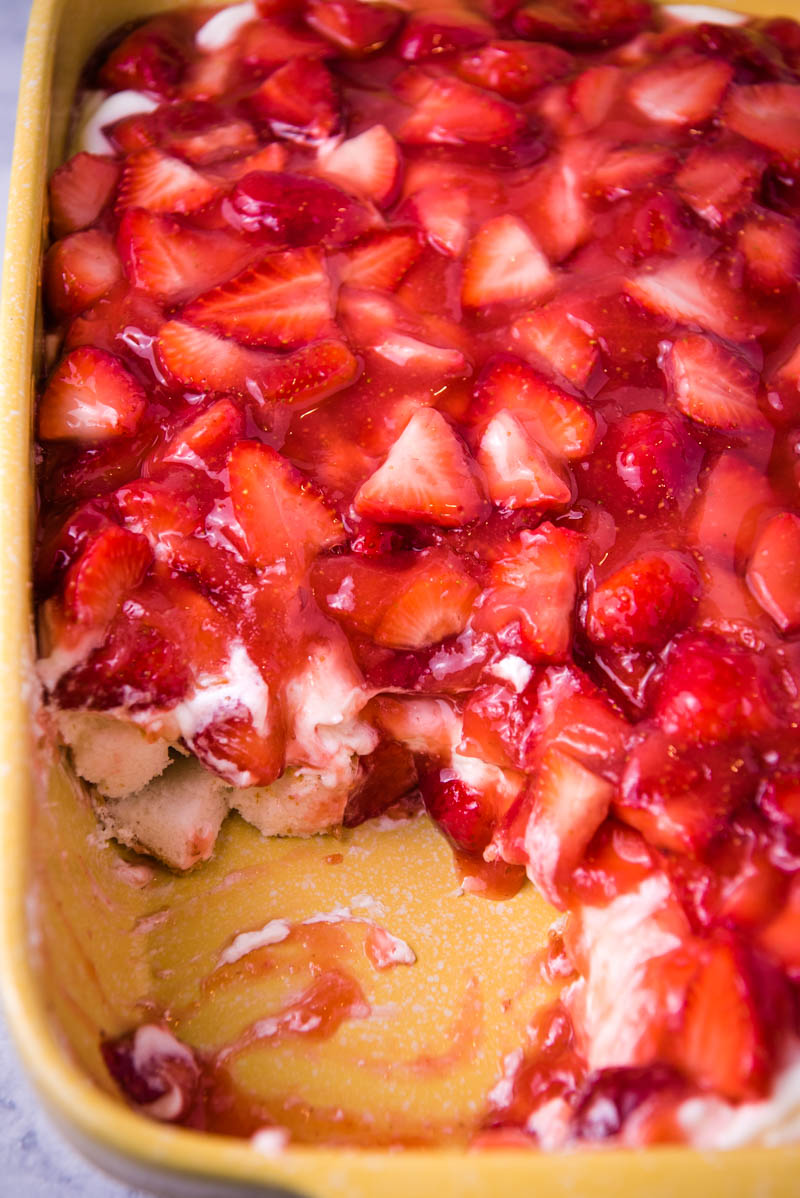 strawberry delight with angel food cake layered in yellow baking dish