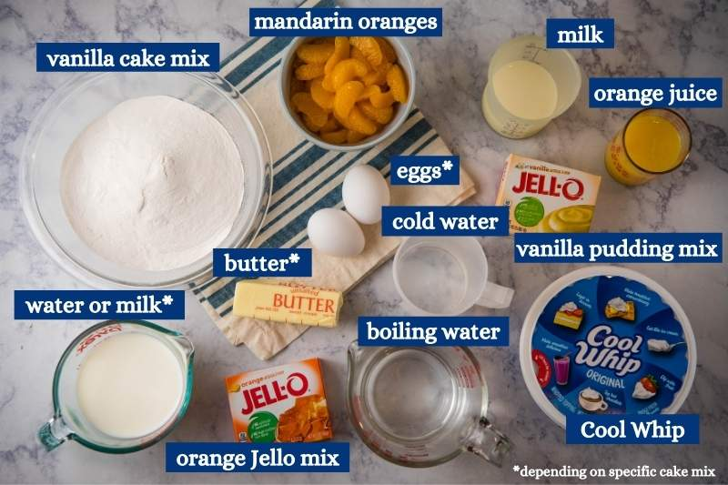 ingredients for orange Jello cake in various bowls on white marble countertop