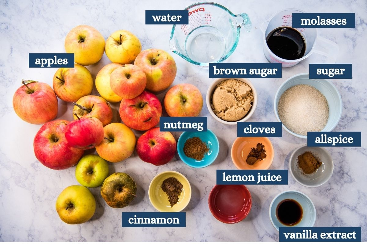 Instant Pot apple butter ingredients on white marble countertop