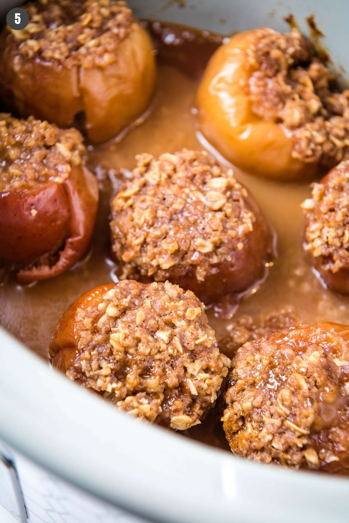 baked apples in a gray Crock Pot