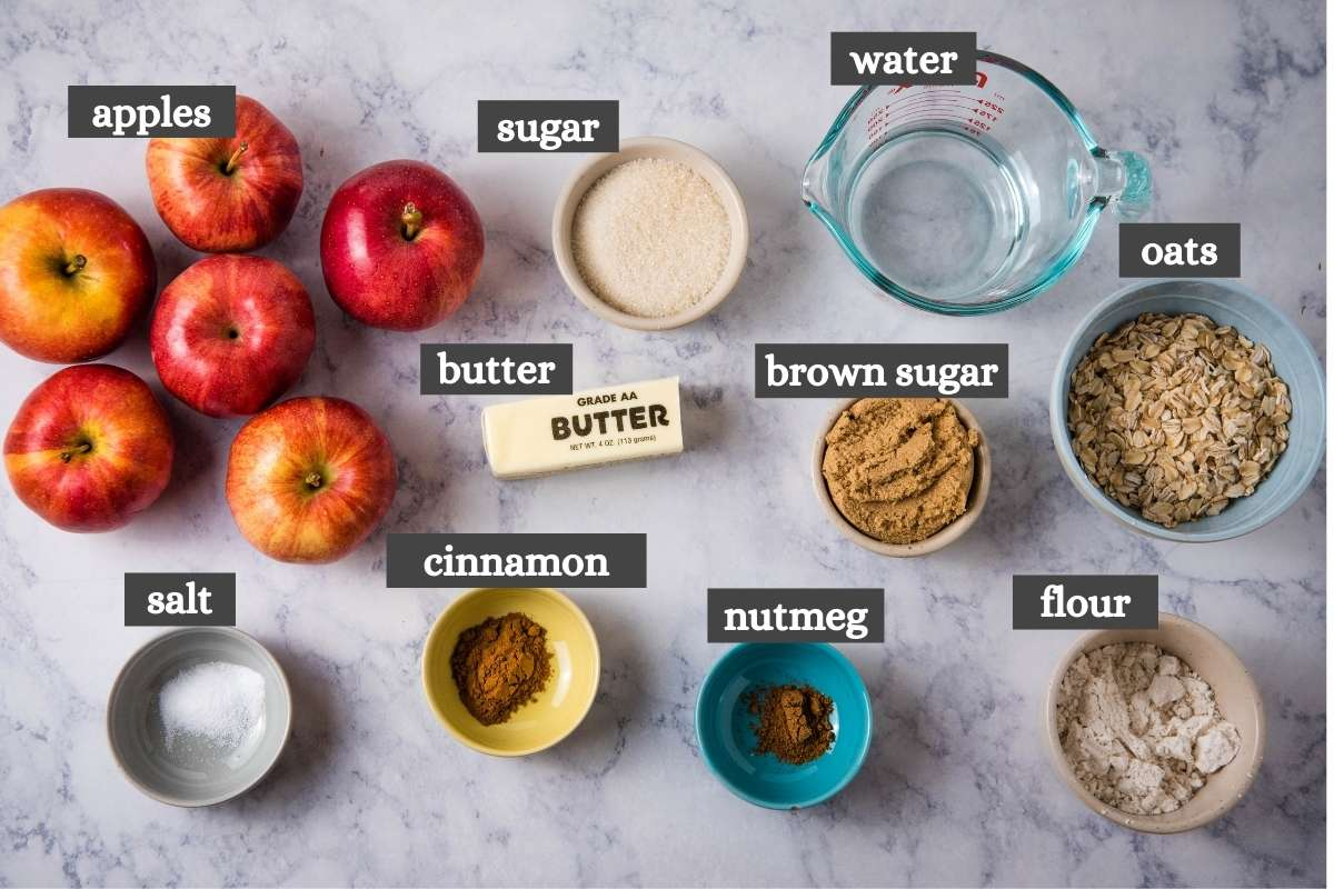 ingredients for making CrockPot baked apples on white marble countertop