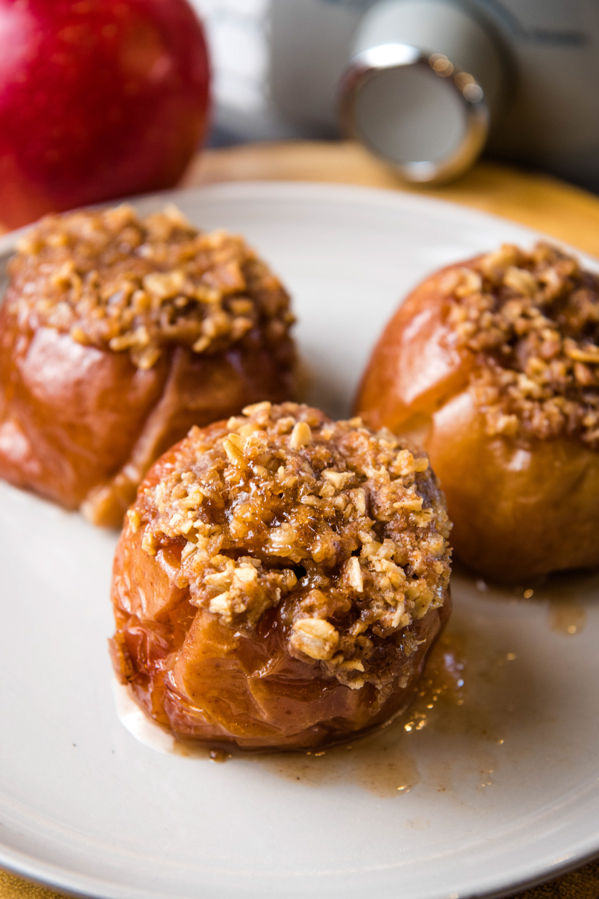 Crock Pot baked apples stuffed with oats on gray plate
